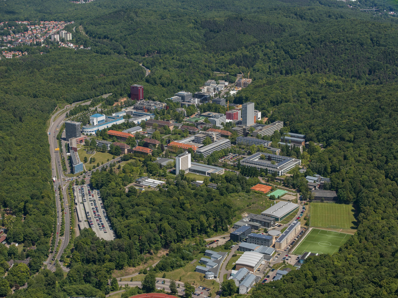 Aerial shot of Universitaet des Saarlandes in the middle of green woods.