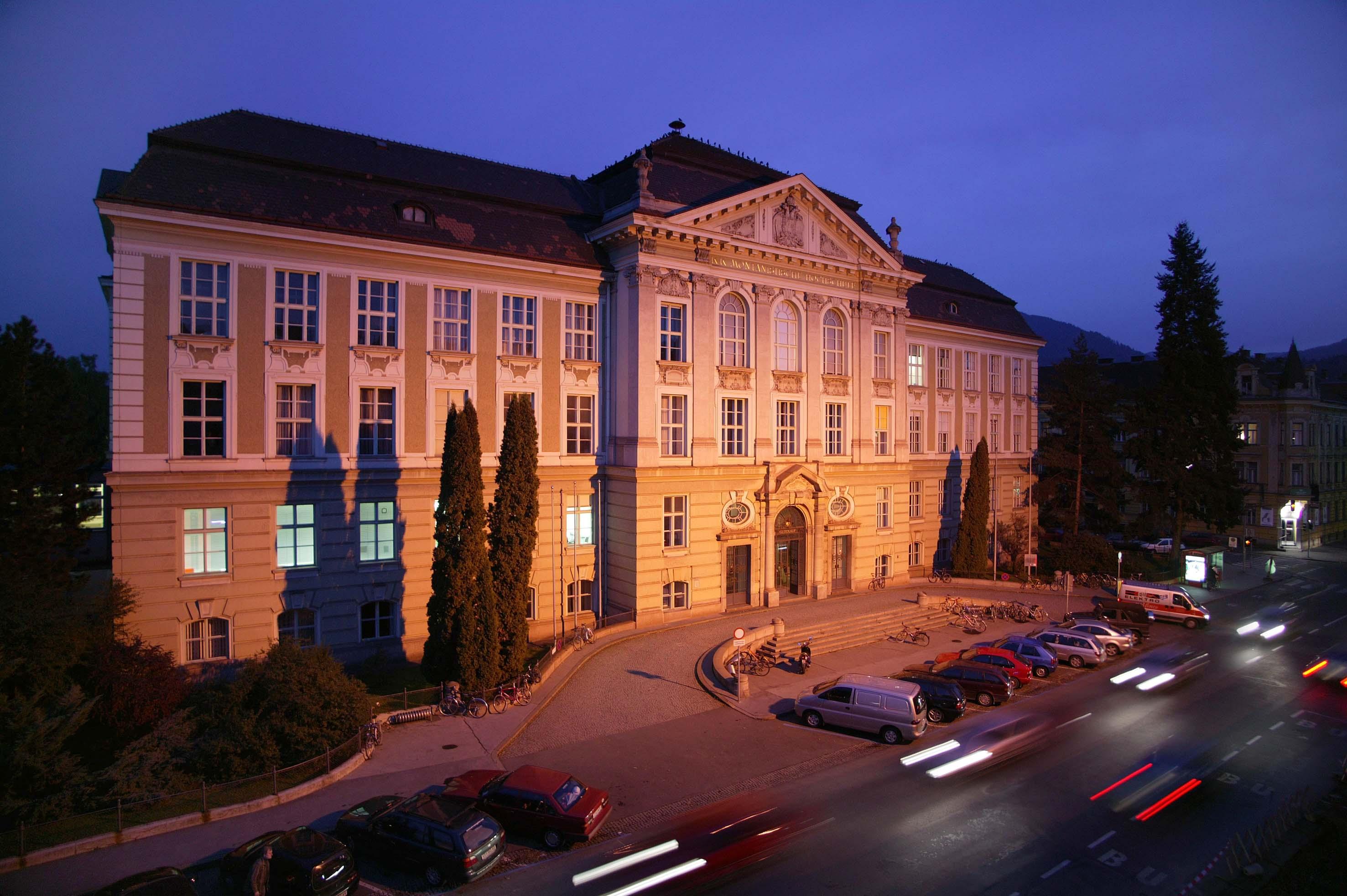 Main building of Montanuniversitaet Leoben at night.