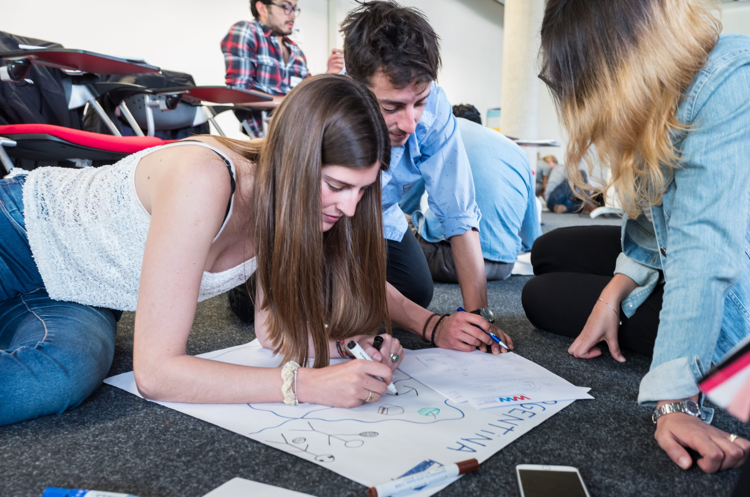 Participants of Integration Week 2018 in AMASE Master Programme working in team during a drawing activity.