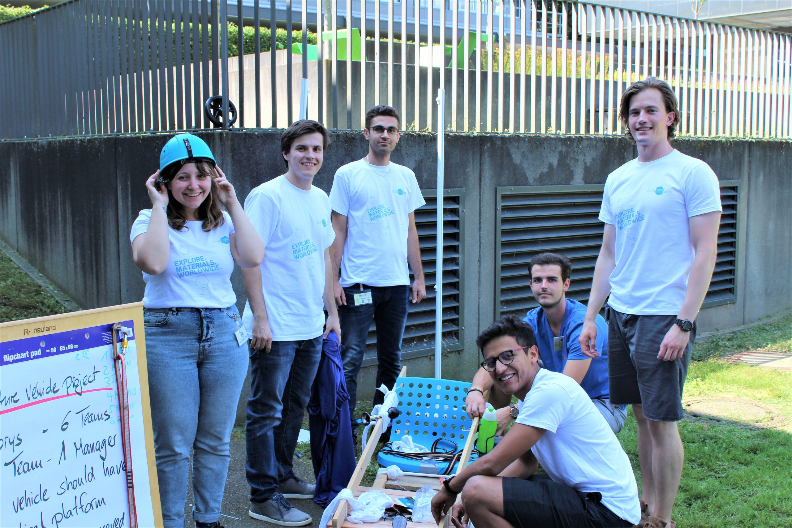 Participants of Integration Week 2019 in AMASE Master Programme working in team and building a racing car.
