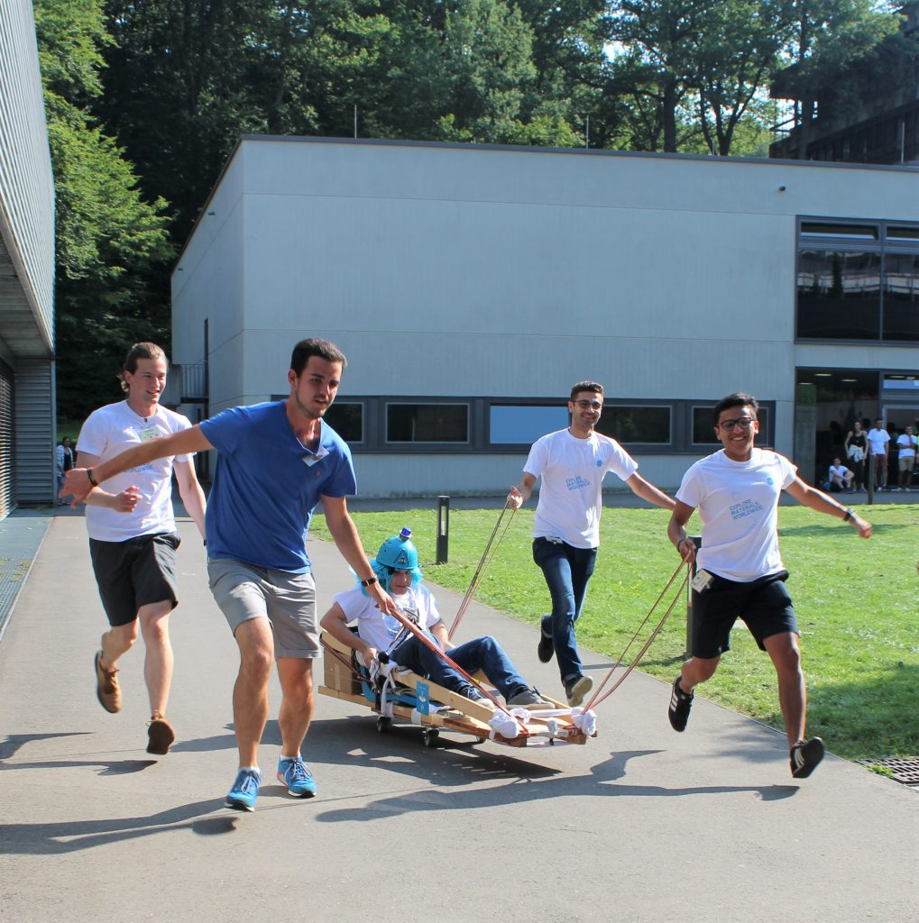 Participants of Integration Week 2019 in AMASE Master Programme running with self-built racing car.